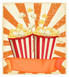 Popcorn in cups with banner Stock Images