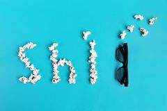 Popcorn and 3d glasses on blue background. Concept pastime, entertainment and cinema. Bad movie concept royalty free stock images