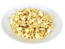 Popcorn in dish. On white background Stock Photo