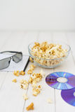 Popcorn and disks and 3D glasses Stock Image