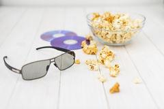 Popcorn and disks and 3D glasses Stock Photo