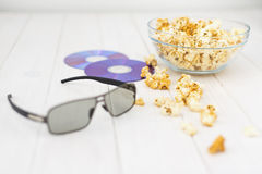 Popcorn and disks and 3D glasses Royalty Free Stock Photo