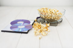 Popcorn and disks and 3D glasses Royalty Free Stock Images