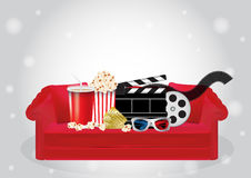 Popcorn, drink, Movie Film, 3d Glasses and movie ticket on a red sofa Royalty Free Stock Photos