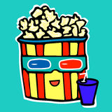 Popcorn drinks cola while watching a movie in a Royalty Free Stock Photo