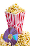 Popcorn and DVD. Home movie night concept with a bucket of popcorn and a DVD Royalty Free Stock Photo