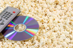 Popcorn dvd disc and remote Stock Images