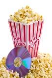 Popcorn e DVD Fotografia Stock Libera da Diritti
