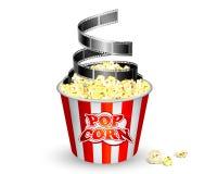 Popcorn e pellicola Fotografie Stock
