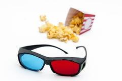 Popcorn e vetri 3D Immagine Stock