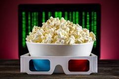 Popcorn e vetri 3D Immagini Stock