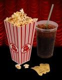 Popcorn en film stock foto