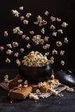 Popcorn exploding inside the clay pot Stock Photos