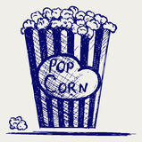 Popcorn exploding inside the packaging Royalty Free Stock Photos