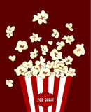 Popcorn exploding inside the red white striped packaging. Vector cinema food. Container with overflowing maize. Popcorn exploding inside the red white striped Stock Image