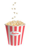 Popcorn falling into a classic striped bucket Stock Photo