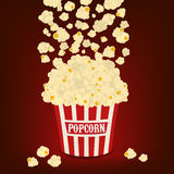 Popcorn falling in the popcorn bag vector Stock Photography
