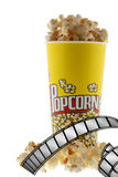 Popcorn and film. Grains of corn are isolated on a white background stock photography