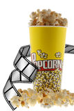 Popcorn and film. Grains of corn are isolated on a white background royalty free stock photography