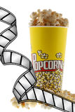 Popcorn and film. Grains of corn are isolated on a white background stock image