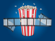 Popcorn and film Royalty Free Stock Image