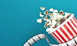 Popcorn with film strip. On blue background Royalty Free Stock Images