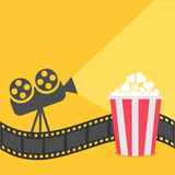 Popcorn. Film strip border. Cinema projector with ray of light.. Cinema movie night icon in flat design style. Yellow background.  Vector illustration Stock Photo