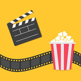 Popcorn. Film strip border. Open movie clapper board icon. Red yellow box. Cinema movie night icon in flat design style. Royalty Free Stock Photography