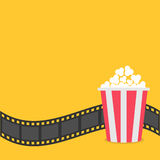 Popcorn. Film strip border. Red yellow box. Cinema movie night icon in flat design style. Yellow background. Vector illustration Royalty Free Stock Photo