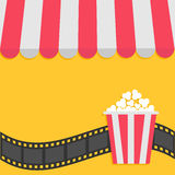 Popcorn. Film strip. Cinema icon. Striped store awning for shop, marketplace, cafe, restaurant. Red white canopy roof. Flat design. Yellow background Isolated Royalty Free Stock Photos