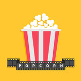 Popcorn. Film strip ribbon line with text. Red white box container. Cinema movie night icon in flat design style. Yellow backgroun. D. Vector illustration Stock Photo