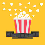 Popcorn. Film strip ribbon. Red yellow box. Cinema movie night icon in flat design style. Royalty Free Stock Photos