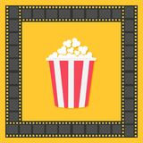 Popcorn. Film strip square frame. Red yellow box. Cinema movie night icon in flat design style. Yellow background. . Royalty Free Stock Images