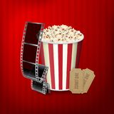Popcorn, film strip and tickets. Cinema attributes. EPS10 vector Royalty Free Stock Images