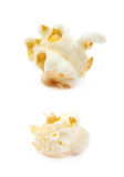 Popcorn flake isolated. Cooked popcorn flake isolated over the white background, set of two different foreshortenings Royalty Free Stock Photography