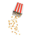 Popcorn with flying kernels from red Royalty Free Stock Photography