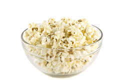 Popcorn in glass bowl. Popcorn in the clear glass bowl on white background Stock Photo