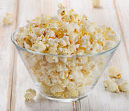 Popcorn in glass bowl Stock Images
