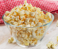 Popcorn. In glass bowl on a wooden table. Selective focus Stock Photos