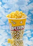 Popcorn on glass with cloud Royalty Free Stock Photos