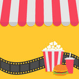 Popcorn, hamburger and soda with straw. Film strip. Cinema icon. Striped store awning for shop, marketplace, cafe, restaurant.  Royalty Free Stock Images