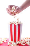 Popcorn and hand on isolated background Royalty Free Stock Image