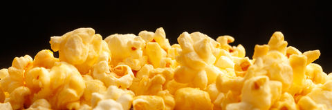 Popcorn heap on black background Royalty Free Stock Photo