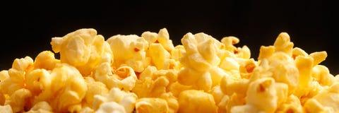 Popcorn heap on black background Royalty Free Stock Photo