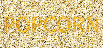 Popcorn heldere gouden inschrijving van de korrel op een witte achtergrond Royalty-vrije Stock Foto