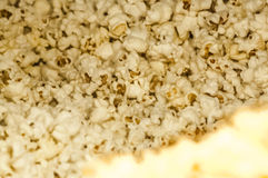 Popcorn. Huge tub of popcorn lots of butter yellow popped Korn royalty free stock images