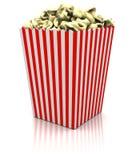 Popcorn i en stor ask Arkivfoto