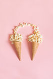 Popcorn in ice cream cones on pink background. Top view. Royalty Free Stock Photo