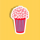Popcorn icon. Colorful popcorn icon on yellow striped background Stock Photography