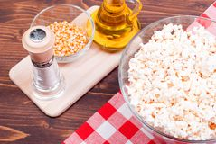 Popcorn and ingredients for cooking popcorn top view Stock Images